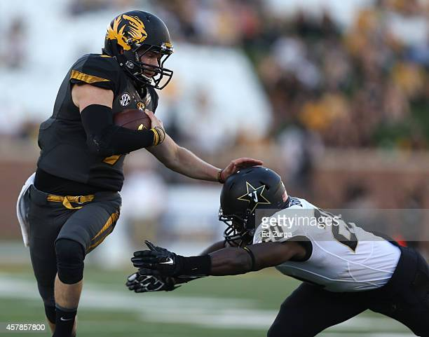 Quarterback Maty Mauk of the Missouri Tigers runs for a first down against Oren Burks of the Vanderbilt Commodores in the third quarter at Memorial...