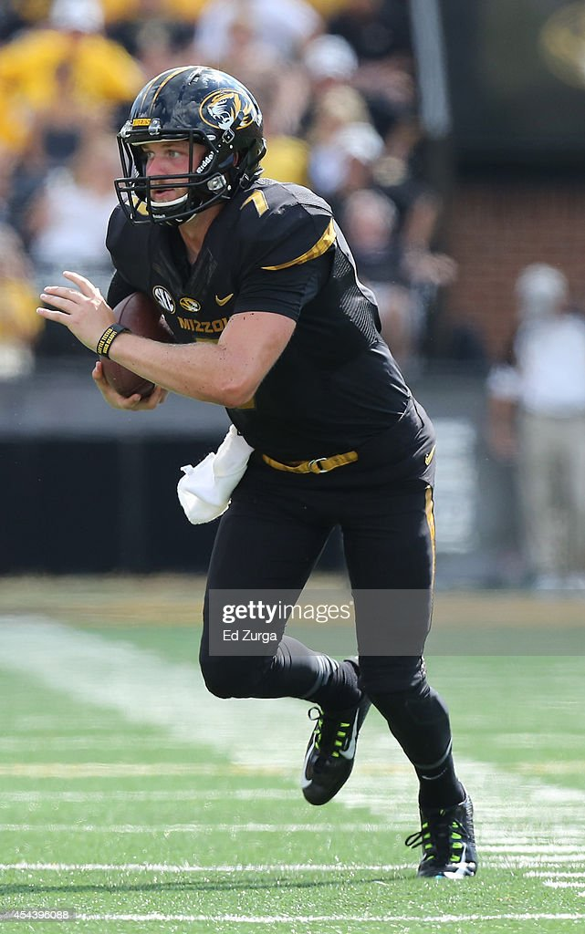 Quarterback Maty Mauk #7 of the Missouri Tigers runs for extra yards against the South Dakota State Jackrabbits in the quarter at Memorial Stadium on August 30, 2014 in Columbia, Missouri.