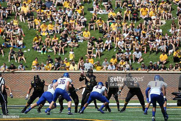 quarterback Maty Mauk of the Missouri Tigers take a snap during a game against the South Dakota State Jackrabbits at Memorial Stadium on August 30...