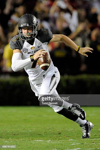 Quarterback Maty Mauk of the Missouri Tigers tries to elude defenders from the South Carolina Gamecocks during the first quarter on September 27 2014...