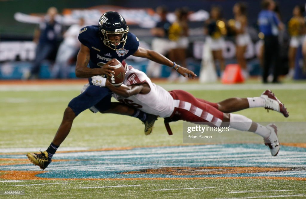 Quarterback Maurice Alexander #3 of the Fiu Golden Panthers is sacked by linebacker Sam Franklin #36 of the Temple Owls during the fourth quarter of the Bad Boy Mowers Gasparilla Bowl on December 21, 2017 at Tropicana Field in St. Petersburg, Florida.