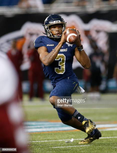 Quarterback Maurice Alexander of the Fiu Golden Panthers looks for a receiver during the third quarter of the Bad Boy Mowers Gasparilla Bowl against...