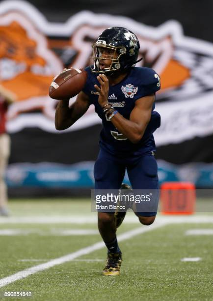 Quarterback Maurice Alexander of the Fiu Golden Panthers looks for an open receiver during the second quarter of the Bad Boy Mowers Gasparilla Bowl...