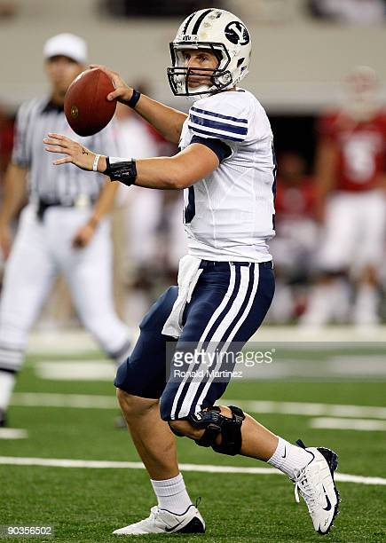 Quarterback Max Hall of the Brigham Young Cougars drops back to pass against the Oklahoma Sooners at Cowboys Stadium on September 5, 2009 in...