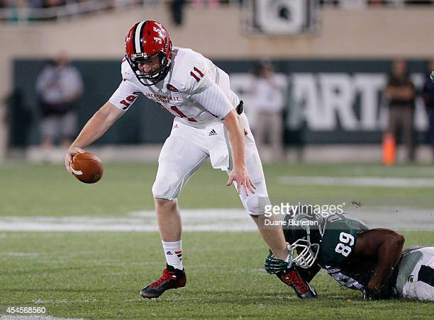 Quarterback Max Shortell of the Jacksonville State Gamecocks is sacked by defensive end Shilique Calhoun of the Michigan State Spartans during the...
