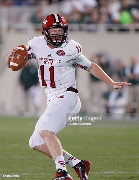 Quarterback Max Shortell of the Jacksonville State Gamecocks scrambles to pass the ball during the second half at Spartan Stadium on August 29 2014...