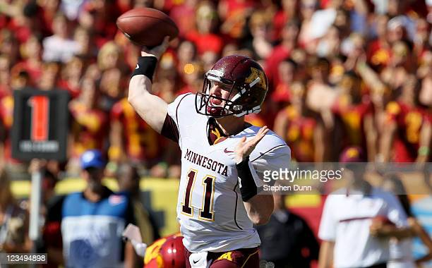 Quarterback Max Shortell of the Minnesota Golden Gophers throws a pass against the USC Trojans at the Los Angeles Memorial Coliseum on September 3...