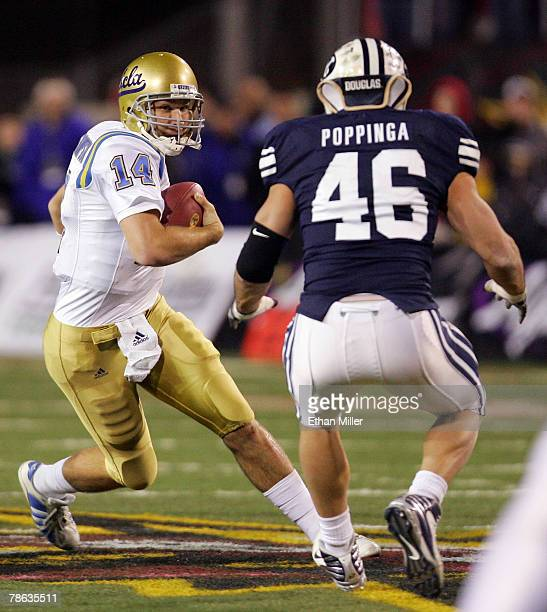 Quarterback McLeod Bethel-Thompson of the UCLA Bruins tries to evade linebacker Kelly Poppinga of the Brigham Young University Cougars in the fourth...