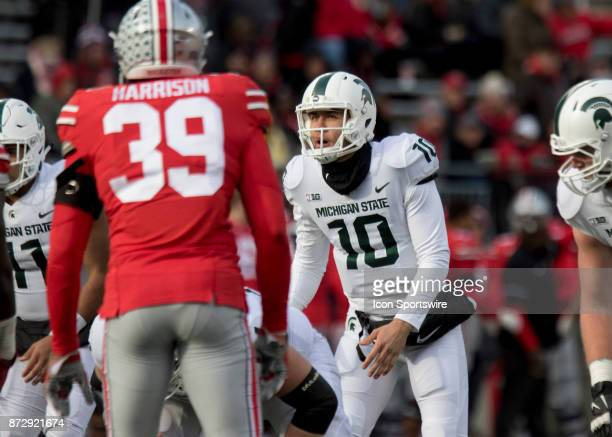 Quarterback Messiah deWeaver of the Michigan State Spartans looks up at the clock during the game between the Ohio State Buckeyes and the Michigan...