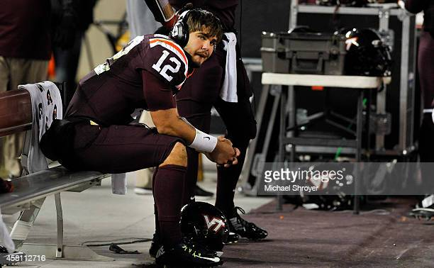Quarterback Michael Brewer of the Virginia Tech Hokies sits on the bench late in the second half against the Miami Hurricanes at Lane Stadium on...