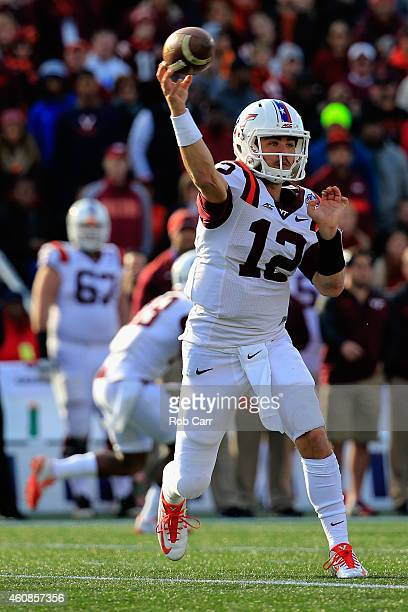 Quarterback Michael Brewer of the Virginia Tech Hokies throws a pass in the first half against the Cincinnati Bearcats during the 2014 Military Bowl...