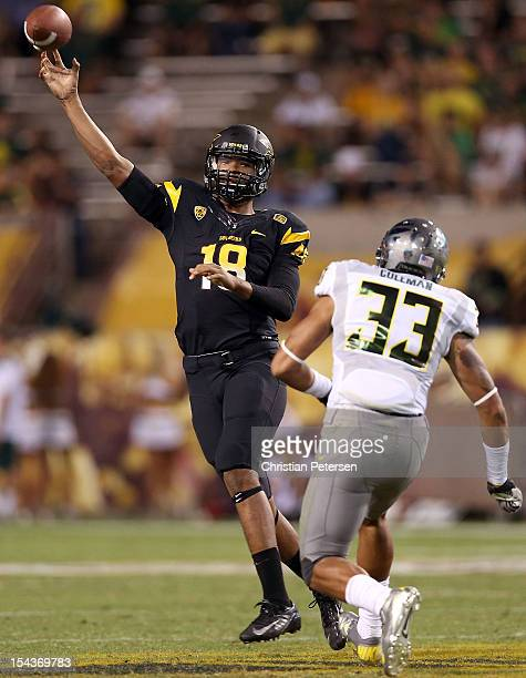 Quarterback Michael Eubank of the Arizona State Sun Devils throws a pass over linebacker Tyson Coleman of the Oregon Ducks during the college...