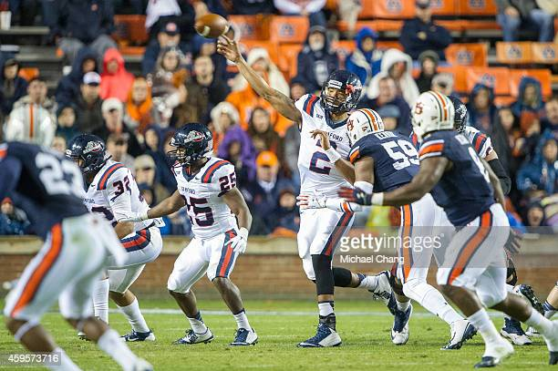 Quarterback Michael Eubank of the Samford Bulldogs throws a pass in traffic during their game against the Auburn Tigers on November 22 2014 at...