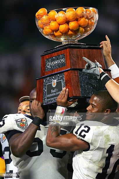 Quarterback Michael Robinson and Matthew Rice of the Penn State Nittany Lions pose with the Orange Bowl Trophy after defeating the Florida State...
