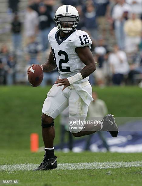 Quarterback Michael Robinson of the Penn State Nittany Lions rolls out to pass against the Northwestern Wildcats September 24, 2005 at Ryan Field in...