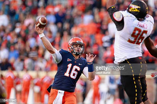 Quarterback Michael Rocco of the Virginia Cavaliers throws the ball over defensive lineman AJ Francis of the Maryland Terrapins at Scott Stadium on...