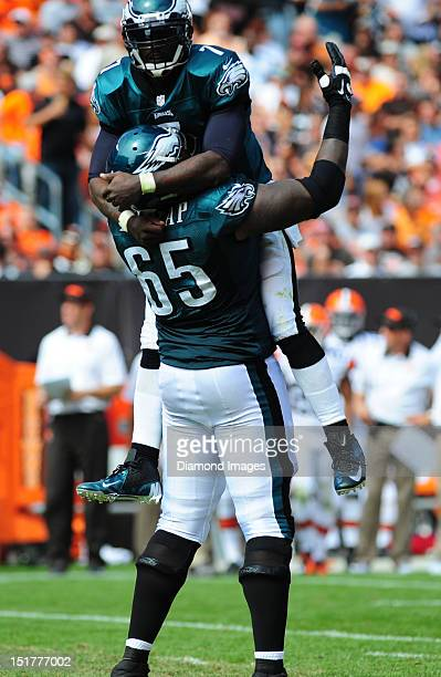 Quarterback Michael Vick and linemen King Dunlap of the Philadelphia Eagles celebrate after a touchdown during a game with the Cleveland Browns at...