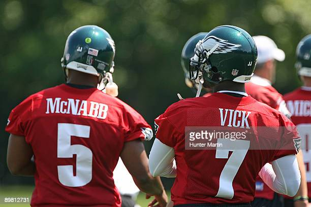 Quarterback Michael Vick and quarterback Donovan McNabb of the Philadelphia Eagles practice during training camp on August 15 2009 at the NovaCare...