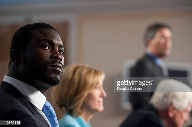 NFL quarterback Michael Vick Betty Sutton DOhio Rep James Moran DVa and Wayne Pacelle president and CEO of the Humane Society of the United States...