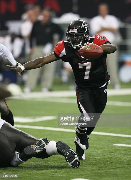 Quarterback Michael Vick of the Atlanta Falcons carries the ball against the Tampa Bay Buccaneers at the Georgia Dome September 17 2006 in Atlanta...
