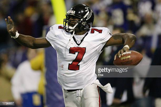 Quarterback Michael Vick of the Atlanta Falcons celebrates his gamewinning touchdown run in overtime against the Minnesota Vikings on December 1 2002...