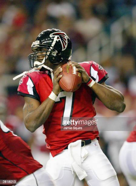 Quarterback Michael Vick of the Atlanta Falcons drops back to pass during the game against the Carolina Panthers on December 7, 2003 at the Georgia...