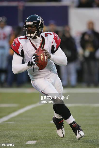 Quarterback Michael Vick of the Atlanta Falcons drops back to pass during the game against the New York Giants at Giant Stadium on November 21, 2004...