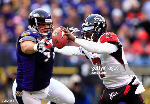 Quarterback Michael Vick of the Atlanta Falcons is sacked by Kelly Gregg of the Baltimore Ravens during the second half of the game on November 19,...