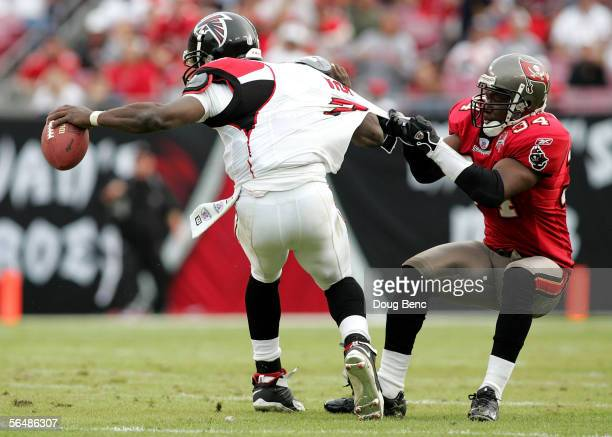 Quarterback Michael Vick of the Atlanta Falcons is sacked by safety Dexter Jackson of the Tampa Bay Buccaneers on December 24, 2005 at Raymond James...