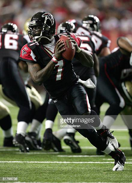 Quarterback Michael Vick of the Atlanta Falcons looks to pass in the first half of the game against the New Orleans Saints at the Georgia Dome on...