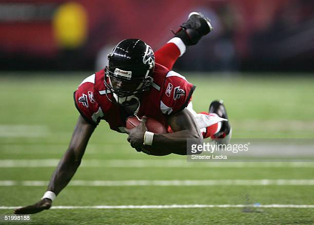 Quarterback Michael Vick of the Atlanta Falcons moves against the defense of the St Louis Rams during the first quarter the NFC Divisional Playoff...