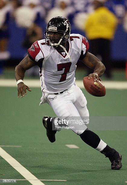 Quarterback Michael Vick of the Atlanta Falcons scrambles during the game against the Indianapolis Colts on December 14, 2003 at the RCA Dome in...