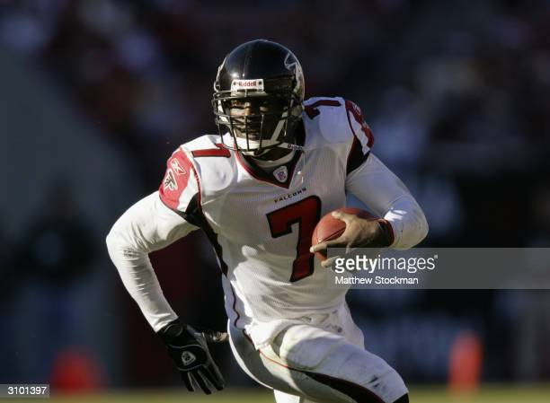 Quarterback Michael Vick of the Atlanta Falcons scrambles during the game against the Tampa Bay Buccaneers on December 20, 2003 at Raymond James...