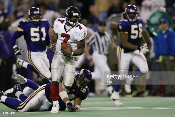Quarterback Michael Vick of the Atlanta Falcons scrambles with the ball during the NFL game against the Minnesota Vikings on December 1 2002 at the...