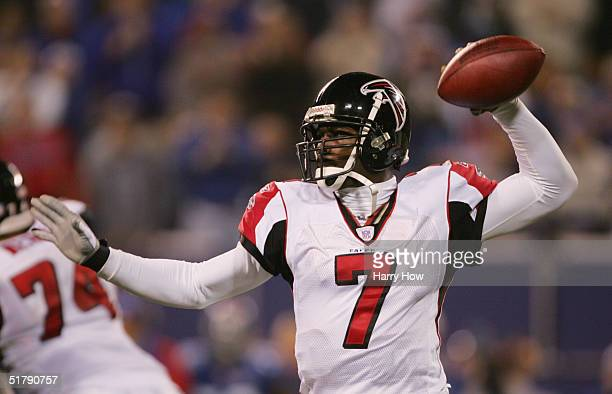Quarterback Michael Vick of the Atlanta Falcons sets to pass during the game against the New York Giants at Giant Stadium on November 21, 2004 in...