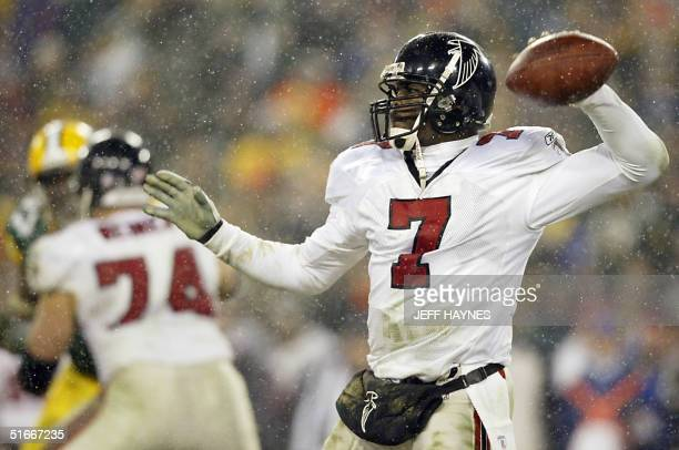 Quarterback Michael Vick of the Atlanta Falcons throws a pass against the Green Bay Packers during the second half of the NFC WildCard game 04...