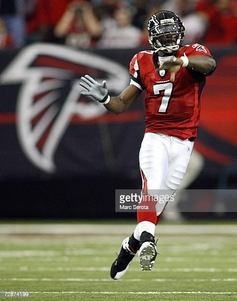 Quarterback Michael Vick of the Atlanta Falcons throws the ball against the Carolina Panthers December 24, 2006 at The Georgia Dome in Atlanta,Georgia