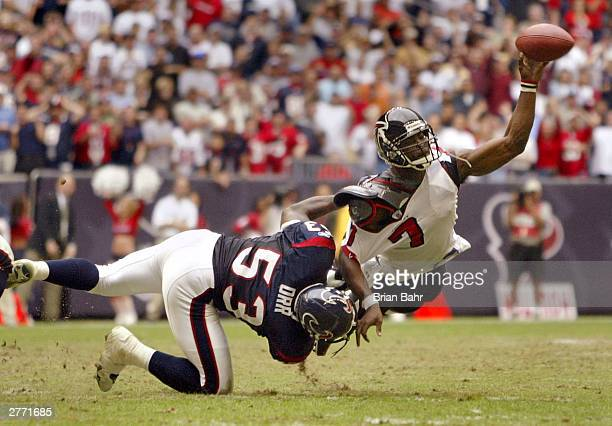 Quarterback Michael Vick of the Atlanta Falcons tries to get rid of the ball but gets called for intentional grounding as he gets sacked by...
