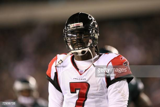 Quarterback Michael Vick of the Atlanta Falcons walks off the field in frustration during the game against the Philadelphia Eagles on December 31...