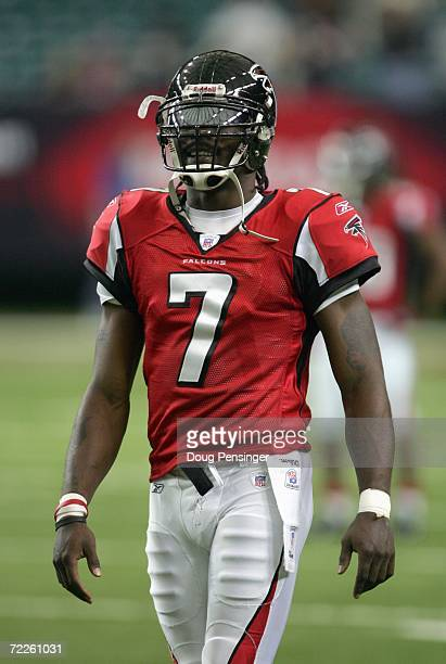 Quarterback Michael Vick of the Atlanta Falcons walks on the field during the game against the Pittsburgh Steelers on October 22, 2006 at the Georgia...