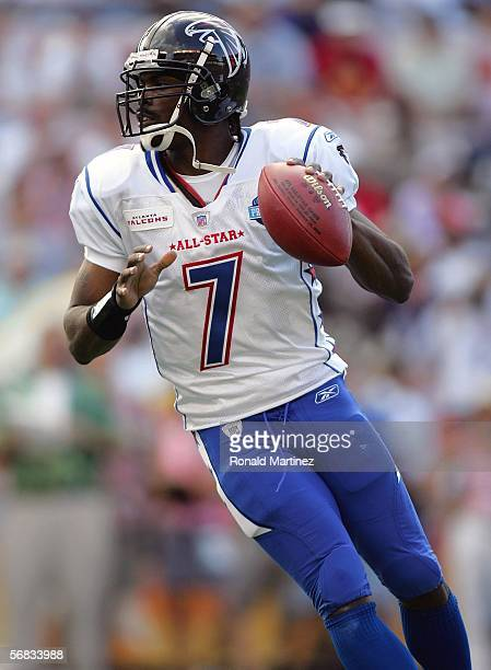Quarterback Michael Vick of the NFC team drops back to pass against the AFC team during the NFL Pro Bowl on February 12 2006 at Aloha Stadium in...