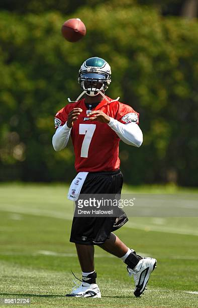 Quarterback Michael Vick of the Philadelphia Eagles catches a pass thrown by quarterback Donovan McNabb during training camp on August 15 2009 at the...