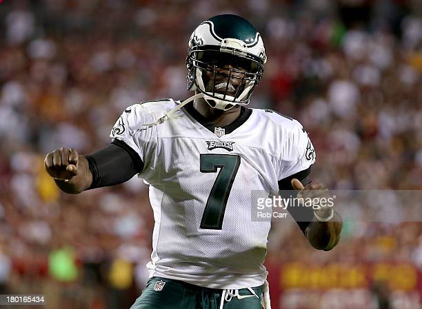 Quarterback Michael Vick of the Philadelphia Eagles celebrates after scoring on a three-yard touchdown run in the second quarter against the...