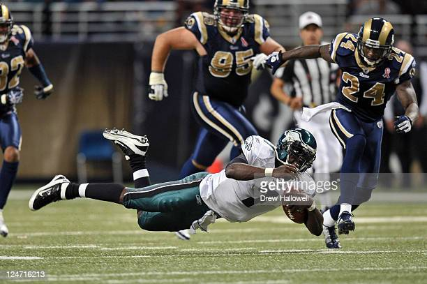 Quarterback Michael Vick of the Philadelphia Eagles dives for extra yards during the game against the St Louis Rams at the Edward Jones Dome on...