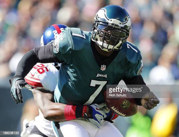 Quarterback Michael Vick of the Philadelphia Eagles fumbles as he is sacked by safety Antrel Rolle of the New York Giants during the first quarter of...