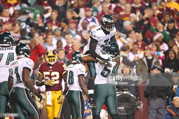 Quarterback Michael Vick of the Philadelphia Eagles is congratulated by center Nick Cole after a touchdown during a game against the Washington...