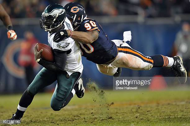 Quarterback Michael Vick of the Philadelphia Eagles is tackled by defensive end Julius Peppers of the Chicago Bears at Soldier Field on November 28,...