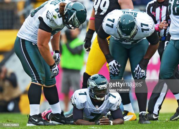 Quarterback Michael Vick of the Philadelphia Eagles lays on the field after giving up a fumble during the game against the Pittsburgh Steelers at...