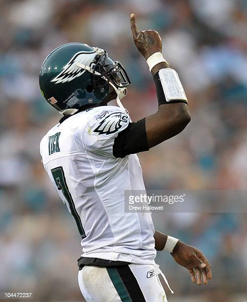 Quarterback Michael Vick of the Philadelphia Eagles points to the sky after a touchdown pass during the game against the Jacksonville Jaguars at...