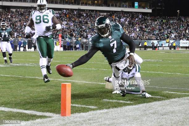 Quarterback Michael Vick of the Philadelphia Eagles runs for a touchdown during a game against the New York Jets on December 18, 2011 at Lincoln...
